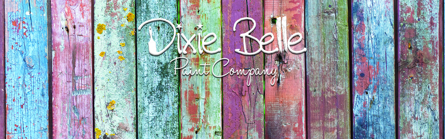 Dixie Belle Paint logo on a weathered plank fence